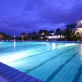 Exterior night view. Outdoor pool
