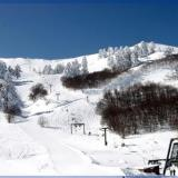 Vassilitsa, a white and black landscape under a blue sky