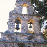 Dragano, the bell-tower of Ypapanti church that has significant icons