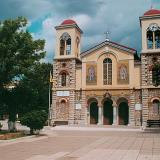 A view of Kalavryta central square church - the left clock stopped when the German army started killing the manhood in 1943