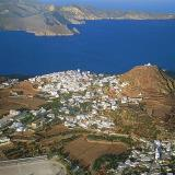 A panoramic view of Plaka & the Castle on top of the hill overlooking the Gulf of Milios