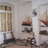 Gialos, a room of the Nautical Museum with paintings and ship models