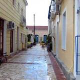 Ithaki, paved street and traditional buildings
