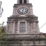 Lagadia, the stone Tower clock (1910) of the Church of Taxiarches