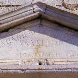 Carved marble on the pediment of today's school.