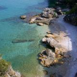 Picturesque cove by Poros Rock