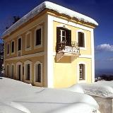 Traditional building covered with snow