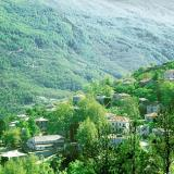 Kissos village surrounded by mountains with forests