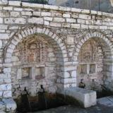 Stone-built arched fountain construction